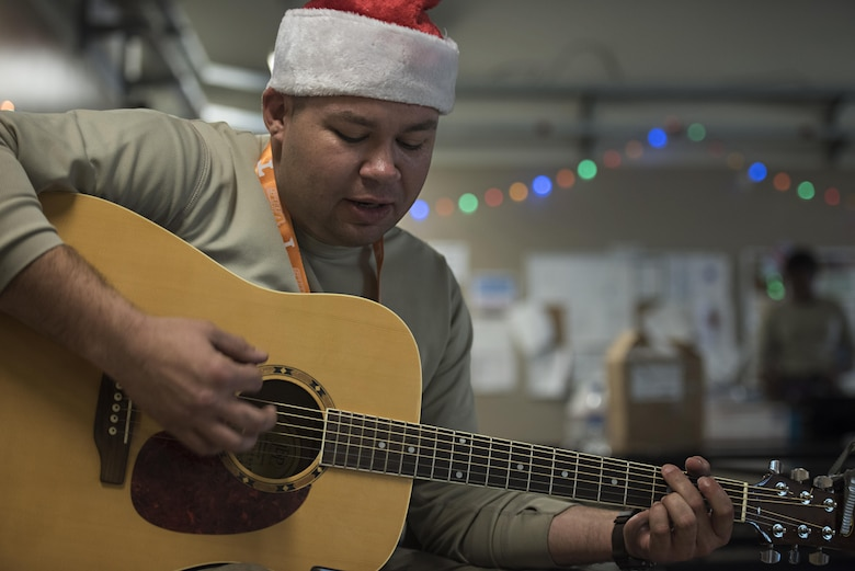 Tech. Sgt. Joe Collett, 455th Expeditionary Aircraft Maintenance Squadron expeditor, plays Christmas Carols Dec. 25, 2016 at Bagram Airfield, Afghanistan. The mission continued over the holiday, but service members took time to celebrate the holiday by talking with their families and spending time with their units. (U.S. Air Force photo by Staff Sgt. Katherine Spessa)
