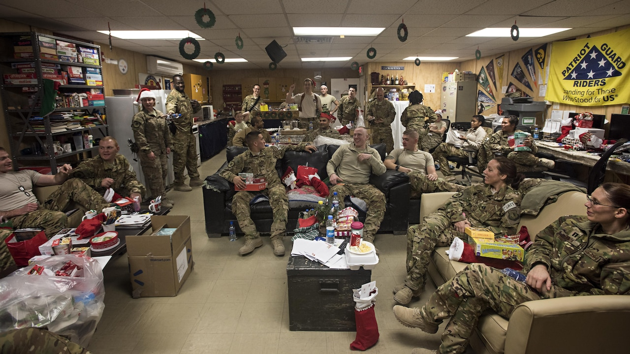 Members of the 455th Expeditionary Aeromedical Evacuation Squadron participate in a white elephant gift exchange Dec. 25, 2016 at Bagram Airfield, Afghanistan. The mission continued over the holiday, but service members took time to celebrate the holiday by talking with their families and spending time with their units. (U.S. Air Force photo by Staff Sgt. Katherine Spessa)