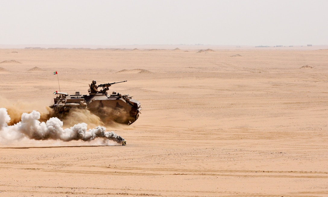 A United Arab Emirate Boyevaya Mashina Pekhoty moves across the desert to engage a simulated target during a joint exercise at Udairi range, Kuwait, Sept. 27. U.S. and UAE forces trained together during a multi-day exercise designed to test armored vehicle maneuver and reaction capabilities. (U.S. Army Photos by Sgt. Aaron Ellerman)