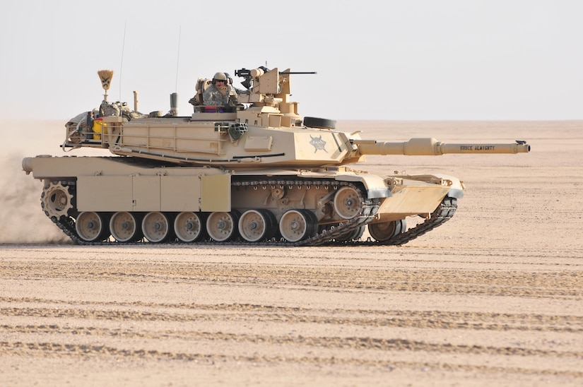 U.S. Army and Kuwaiti Land and Air forces move to engage targets during a joint combined arms live-fire exercise near Camp Buehring, Kuwait Dec. 6-7, 2016. The multi-day exercise was designed to test the efficiency of the forces abilities to identify and eliminate enemies' anti-aircraft capabilities. Around 30 M1 Abrams Main Battle Tanks, two Kuwaiti AH-64 Apache helicopters, Several Bradley Armored Fighting Vehicles, scout sniper teams, 120mm mortar teams, and M109 Self Propelled Howitzer artillery fire, assaulted mock enemy positions during the exercise. (U.S. Army photo by Sgt. Aaron Ellerman)