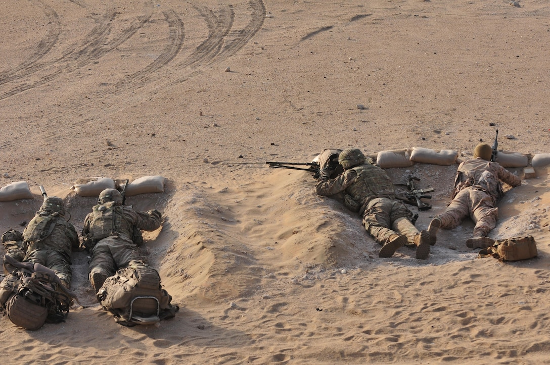 Sniper teams from the 3rd Armored Brigade Combat Team, 1st Armored Division, and Kuwaiti Land Forces engage a target during a joint combined arms live-fire exercise near Camp Buehring, Kuwait Dec. 6-7, 2016. The multi-day exercise was designed to test the efficiency of the U.S. Army and Kuwaiti Land and Air forces abilities to identify and eliminate enemies' anti-aircraft capabilities. Around 30 M1 Abrams Main Battle Tanks, two Kuwaiti AH-64 Apache helicopters, several Bradley Armored Fighting Vehicles, scout sniper teams, 120mm mortar teams, and M109 Self Propelled Howitzer artillery fire assaulted mock enemy positions during the exercise. (U.S. Army photo by Sgt. Aaron Ellerman)