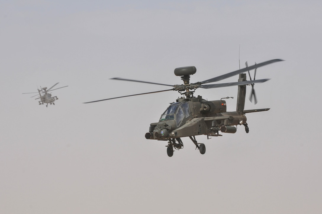AH-64 Apache Helicopters prepare to engage a target during a joint combined arms live-fire exercise near Camp Buehring, Kuwait Dec. 6-7, 2016. The multi-day exercise was designed to test the efficiency of the U.S. Army and Kuwaiti Land and Air forces abilities to identify and eliminate enemies' anti-aircraft capabilities. Around 30 M1 Abrams Main Battle Tanks, two Kuwaiti AH-64 Apache helicopters, several Bradley Armored Fighting Vehicles, scout sniper teams, 120mm mortar teams, and M109 Self Propelled Howitzer artillery fire assaulted mock enemy positions during the exercise. (U.S. Army photo by Sgt. Aaron Ellerman)
