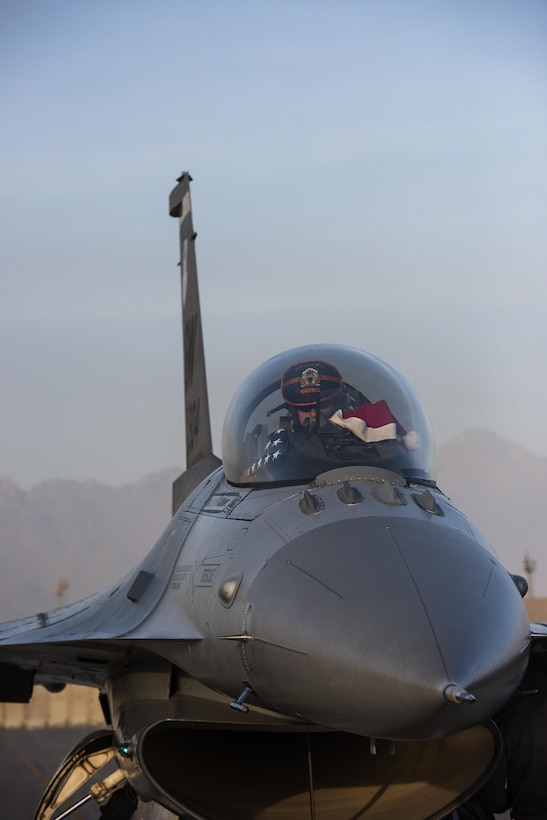 Capt. Ashton, 79th Expeditionary Fighter Squadron F-16 Fighting Falcon pilot, prepares to taxi before launching on a mission Dec. 25, 2016 from Bagram Airfield, Afghanistan. While units offered their members time to connect with families and celebrate Christmas, the mission still continued and 679 operations were flown that day. (U.S. Air Force photo by Staff Sgt. Katherine Spessa)
