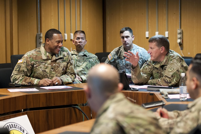 Maj. Gen. Mark Palzer, right, Commanding General of the 79th Sustainment Command (Support), advises Col. Vincent Buggs, left, 79th SSC Supports Operations Officer, and other 79th troops as they participate in Exercise Judicious Response '17 in Kaiserslautern, Germany, Dec. 2, 2016. (U.S. Army Photo by Sgt. 1st Class Alexandra Hays, 79th Sustainment Command (Support).