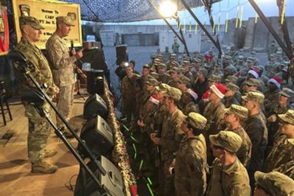 Marine Corps Gen. Joe Dunford, chairman of the Joint Chiefs of Staff, tells service members at Qayyarah West Airfield, Iraq, Dec. 25, 2016, that they are making a difference in the fight against the Islamic State of Iraq and the Levant, and proving that American sacrifices in Iraq are worth it. Dunford brought a USO show to the base for Christmas. DoD photo by Jim Garamone