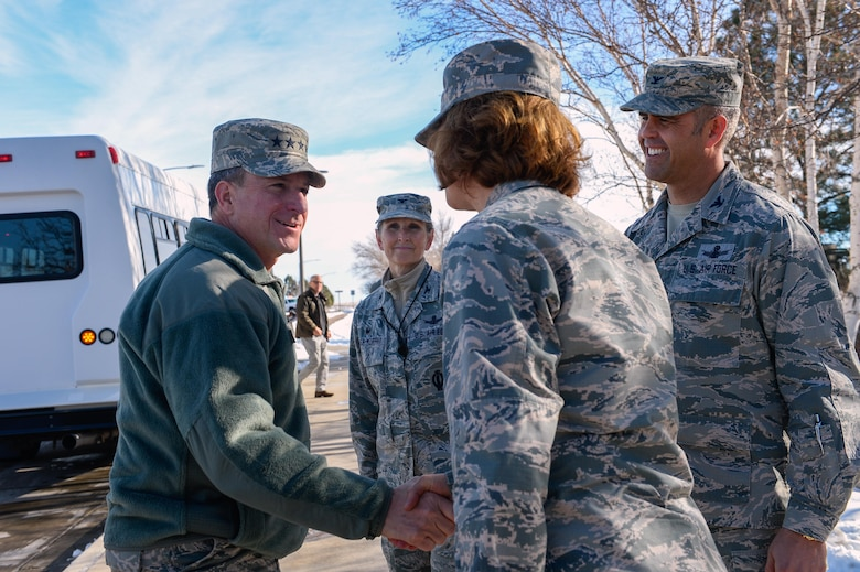 Gen. David L. Goldfein (left), Chief of Staff of the Air Force, greets Col. Robyn Slade, individual mobilization augmentee to the wing commander, Col. Anthony Mastalir, 50 SW vice commander and Col. Traci Kueker-Murphy, 310th Space Wing commander, during his visit at Schriever Air Force Base, Colorado, Tuesday, Dec. 20, 2016. Goldfein and base leadership toured throughout the base, with Goldfein spending his lunch with Airmen answering questions and imparting knowledge. (U.S. Air Force photo/Christopher DeWitt)
