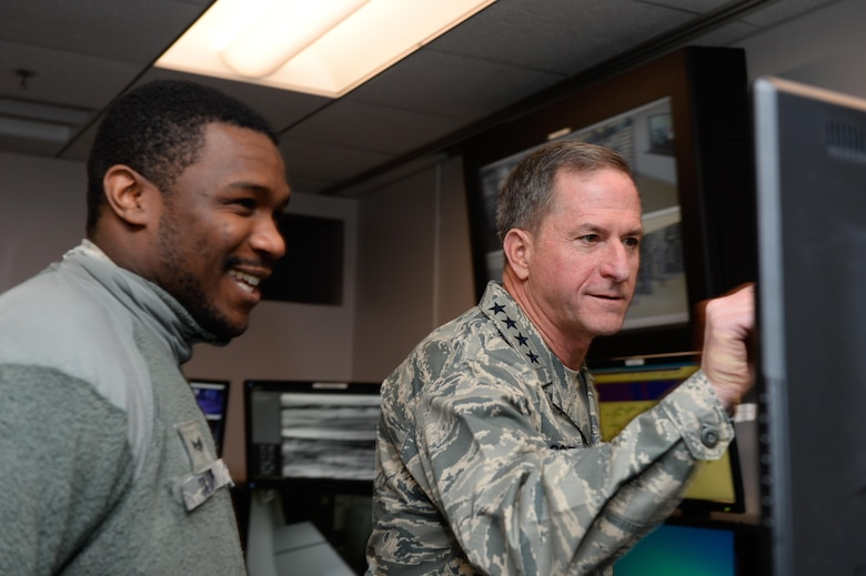 Gen. David L. Goldfein, Chief of Staff of the Air Force, watches a data presentation by Senior Airman James Taylor, 50th Security Forces Squadron, during his visit at Schriever Air Force Base, Colorado, Tuesday, Dec. 20, 2016. As CSAF, Goldfein leads more than 300,000 active duty Air Force personnel. (U.S. Air Force photo/Christopher DeWitt)