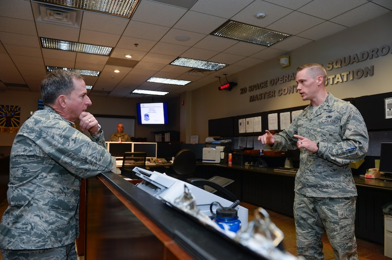 Gen. David L. Goldfein, Chief of Staff of the Air Force, listens to 1st Lt. Mark Skinner, 2nd Space Operations Squadron GPS mission commander, explain current 2 SOPS activities during his visit at Schriever Air Force Base, Colorado, Tuesday, Dec. 20, 2016. Goldfein toured various squadrons across the base during his visit, receiving in-person briefings and engaging with Airmen. (U.S. Air Force photo/Christopher DeWitt)
