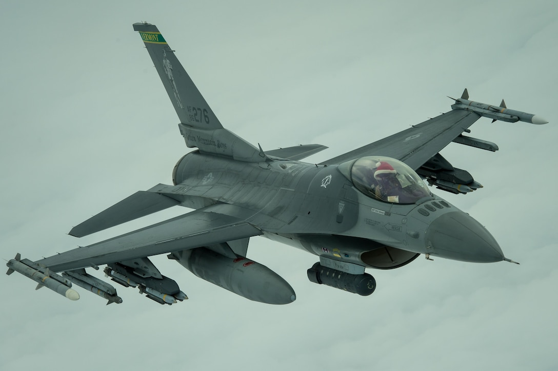 "An F-16 Fighting Falcon disconnects from a KC-10 Extender after a successful refueling over Iraq, Dec. 25, 2016. Many pilots wore a traditional red ""Santa"" hat while flying on Christmas Day. F-16s are providing precision guided close air support during Combined Joint Task Force-Operation Inherent Resolve, a multinational effort to weaken and destroy Islamic State in Iraq and the Levant operations in the Middle East region and around the world. (U.S. Air Force photo 