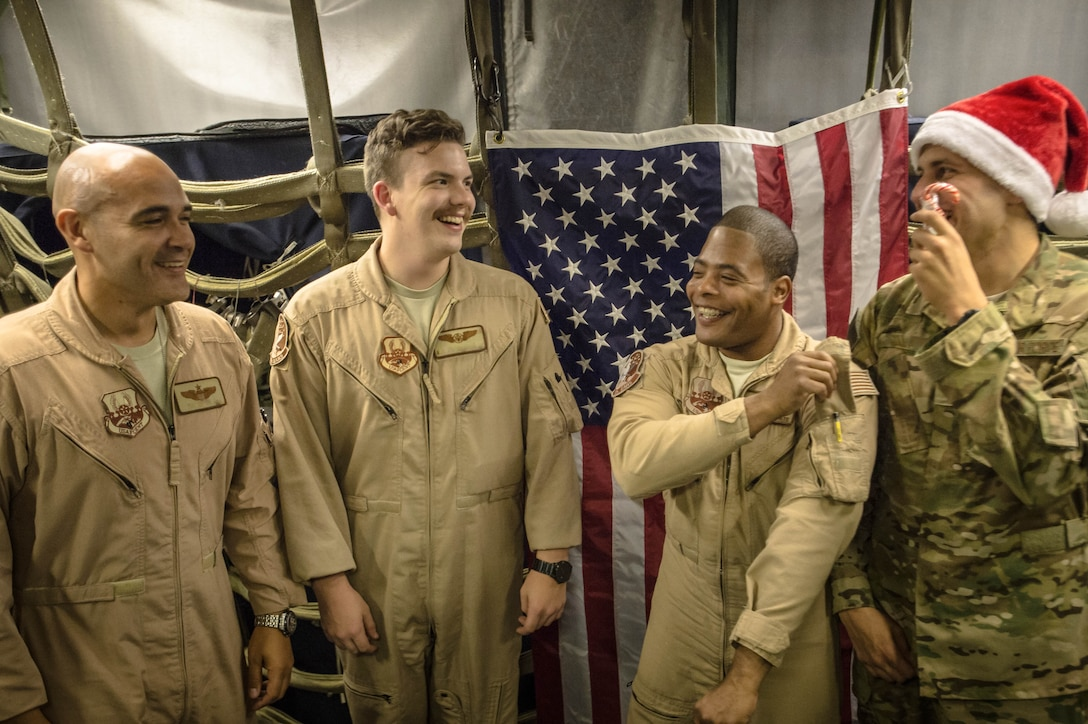 A 380th Air Expeditionary Wing KC-10 Extender aircrew laughs before a group photo after flying a sortie in support of Combined Joint Task Force-Operation Inherent Resolve at an undisclosed location in Southwest Asia, Dec. 25, 2016. KC-10 aircrews have completed more than 1,500 sorties during the liberation of Mosul, Iraq since Oct. 2016. (U.S. Air Force photo/Senior Airman Tyler Woodward)