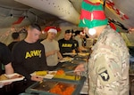 Soldiers enjoy Christmas dinner in Cameroon Dec. 25 with food provided by DLA Troop Support's Subsistence supply chain. U.S. service members are serving in Cameroon to enhance the capability of partner nation militaries like the Cameroonian Defense Force to promote regional security and stability.