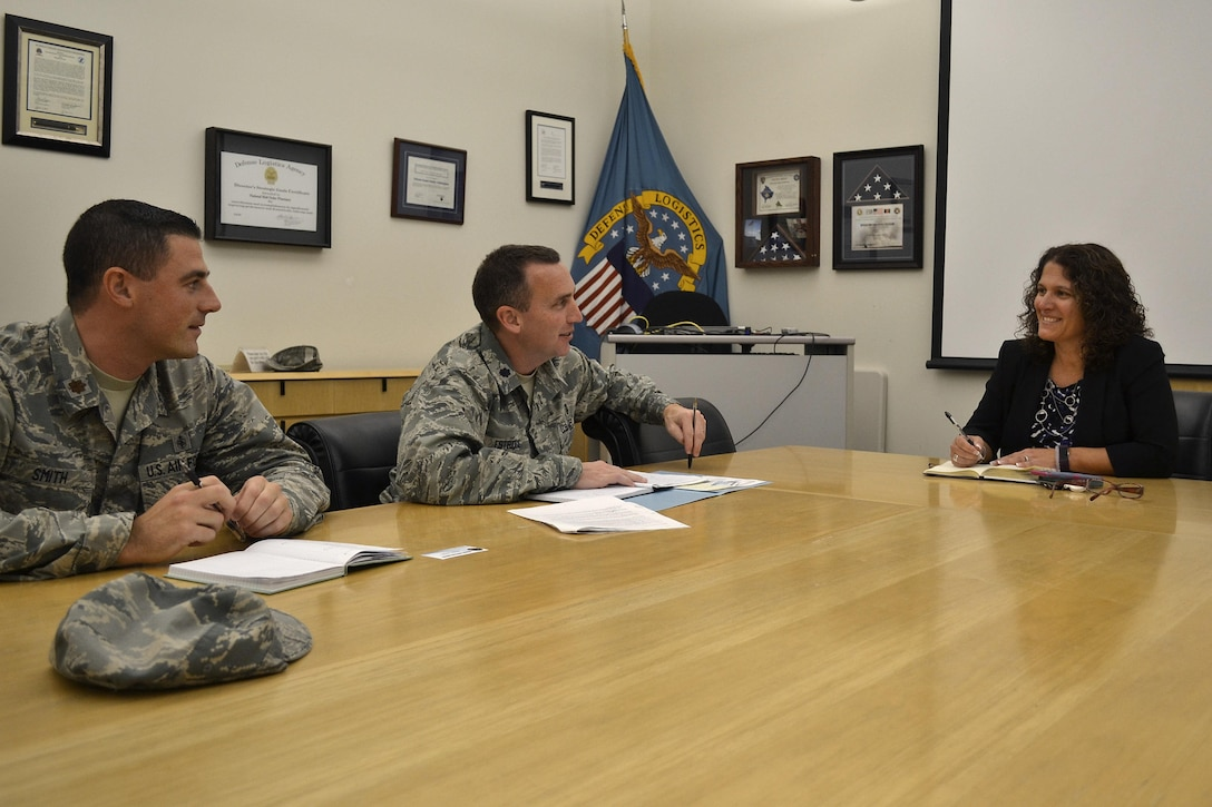 Nora Steigerwalt (left), Medical supply chain director of customer operations, meets with Lt. Col. Christopher Estridge (center) and Maj. Blake Smith, both Air Force medical service corps officers from the Defense Health Agency, at DLA Troop Support in Philadelphia Nov. 16.