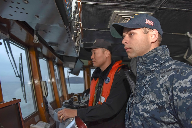 "Lt. j.g. David Dinkins, ships navigator for USS Barry (DDG 52) tours Republic of Korea (ROK) ship Bucheon (PCC 773) during the officer exchange program Combined Edge, Dec. 22, 2016. ""Combined Edge"" is a program focusing on improving combined war fighting integration between the U.S. and ROK navies by allowing U.S. Navy officers to embark on ROK navy ships."