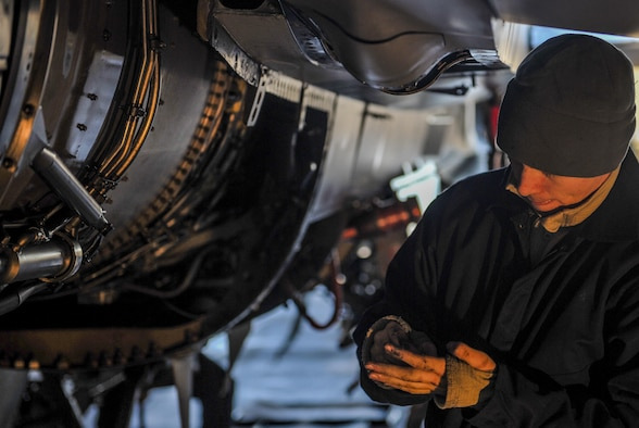 Senior Airman Shane Fortune, 8th Maintenance Squadron phase inspection team member, inspects a part of an F-16 Fighting Falcon at Kunsan Air Base, Republic of Korea, Dec. 6, 2016. Fortune works with a team of Airmen during phase inspections to ensure aircraft are prepared for flight. Phase inspections are performed on aircraft every 400 flight hours and involve procedural maintenance actions that require robust attention to detail. (U.S. Air Force photo by Senior Airman Colville McFee/Released)