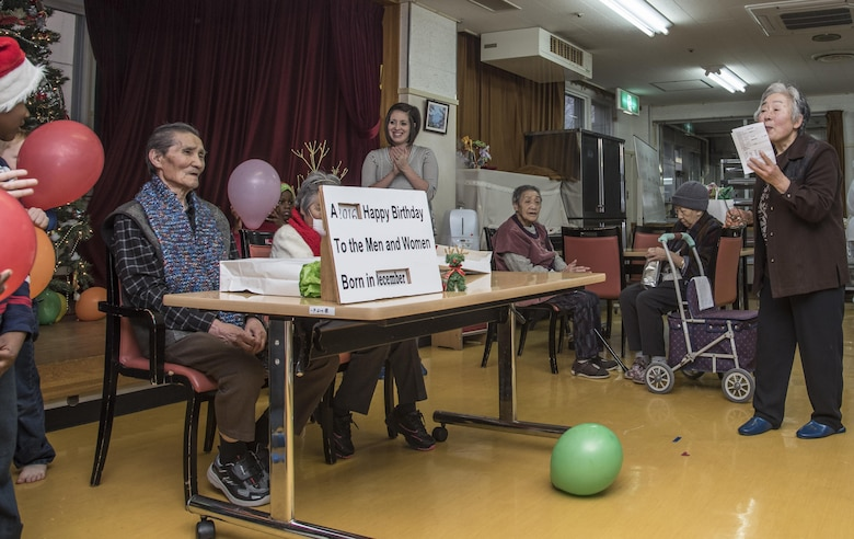Akira, left, a Japanese elder, receives a birthday celebration from Miyako Fukuda, right, a Harunaoka Old Age Home event organizer and caretaker, at Misawa City, Japan, Dec. 22, 2016. Akira, who turned 72-years-old, celebrated his birthday along with others in the month of December. (U.S. Air Force photo by Airman 1st Class Sadie Colbert)