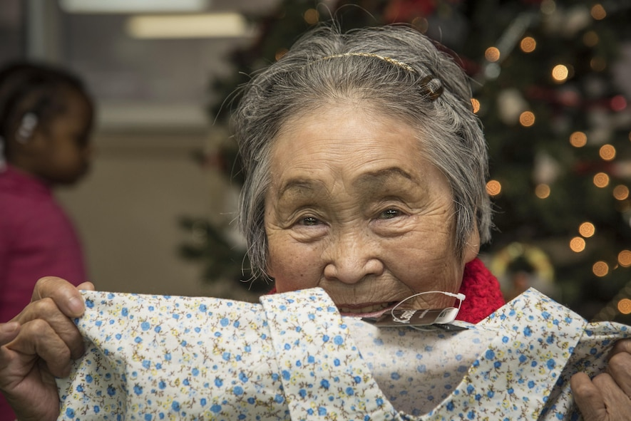 Chiyo, a Japanese elder, holds a gift from Misawa Airmen and families at the Harunaoka Old Age Home, Misawa City, Japan, Dec. 22, 2016. Chiyo celebrated her birthday for turning 84-years-old in December. The facility helps care for elderly in need by providing food and shelter. (U.S. Air Force photo by Airman 1st Class Sadie Colbert)