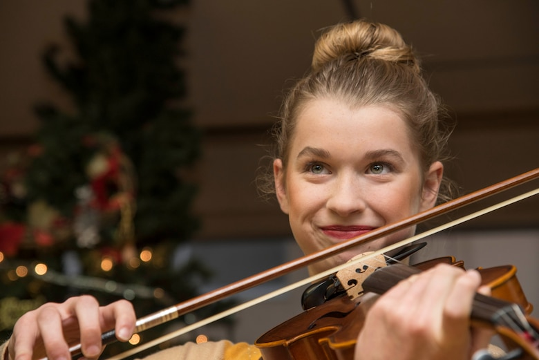 Leah Skaggs, daughter of Tech. Sgt. Erik Skaggs, the 35th Medical Group executive officer, plays the violin for Japanese elders at Harunaoka Old Age Home, Misawa City, Japan, Dec. 22, 2016. During their visit, Airmen and their families sang Christmas songs, gave gifts and played with the members. The Chapel and their groups visit the facility bi-monthly. (U.S. Air Force photo by Airman 1st Class Sadie Colbert)