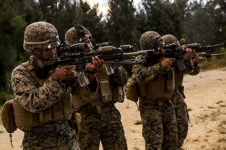Marines with Battalion Landing Team, 2nd Battalion, 5th Marine Regiment, 31st Marine Expeditionary Unit, sight-in with M27 Infantry Automatic Rifles at Camp Hansen, Okinawa, Japan, Dec. 16, 2016. As the Marine Corps' only continuously forward-deployed unit, the 31st MEU air-ground-logistics team provides a flexible force, ready to perform a wide range of military operations, from limited combat to humanitarian assistance operations, through the Indo-Asia Pacific region. (U.S. Marine Corps photo by Lance Cpl. Jorge A. Rosales/ Released)