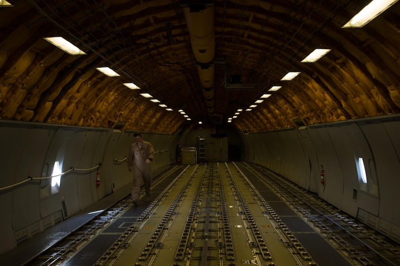 A 380th Air Expeditionary Wing KC-10 Extender boom operator Senior Airman Grant walks toward the cockpit after completing a preflight inspection in the boom pod at an undisclosed location in Southwest Asia, Dec. 25, 2016. 380 AEW KC-10 boom operators have successfully offloaded fuel to more than 5,000 Coalition receivers in support of Combined Joint Task Force-Operation Inherent Resolve since Oct. 2016. (U.S. Air Force photo/Senior Airman Tyler Woodward)