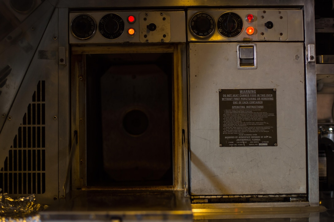 A KC-10 Extender oven is heated for a holiday meal during a sortie supporting Combined Joint Task Force-Operation Inherent Resolve over Iraq, Dec. 25, 2016. During the flight, crew members ate pizza, pita bread, chocolate chip cookies and pita bread. (U.S. Air Force photo/Senior Airman Tyler Woodward)