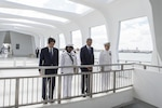From left, Japanese Prime Minister Shinzo Abe, Navy Petty Officer 2nd Class Michelle Wrabley, President Barack Obama and U.S. Pacific Command Commander Navy Adm. Harry B. Harris Jr. pause at the USS Arizona Memorial to honor the service members killed during the Dec. 7, 1941, attacks at Pearl Harbor, Hawaii, Dec. 27, 2016. Abe was the first Japanese prime minister to visit the memorial. Navy photo by Petty Officer 1st Class Jay M. Chu