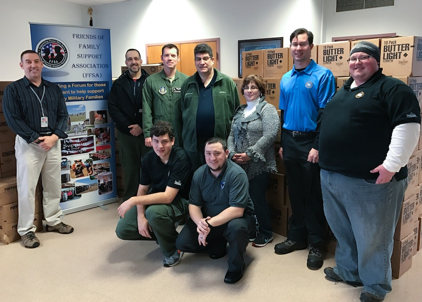 Members of the Boy Scouts of America Greater Niagara Frontier Council delivered 187 cases of popcorn to the Friends of Family Support Association at the Niagara Falls Air Reserve Station, N.Y. Wednesday, December 21, 2016. (U.S. Air Force photo by Staff Sgt. Richard Mekkri)