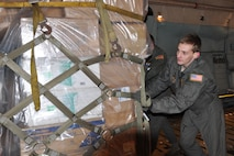 Senior Airman Nicholas Orcutt, a 757th Airlift Squadron loadmaster, assists with pushing a cargo pallet into place on a C-5 Galaxy cargo aircraft. The cargo was bound for Guatemala as part of a Denton cargo mission. The Denton program allows non-governmental organizations, such as the Austintown, Ohio-based Mission of Love Foundation, to use space available on military airlift aircraft to provide humanitarian aid to those in need worldwide. (U.S. Air Force photo/Maj. Polly Orcutt)
