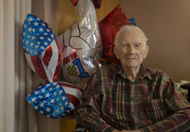 Retired 1st Lt. John J. O'Leary sits in front of birthday balloons at the Evergreen Community of Johnson County, Olathe, Kan., Dec. 21, 2016. O'Leary fought on Guam and witnessed the bombardment of Iwo Jima as a member of 3rd Joint Assault Signal Company. He celebrated his 100th birthday on Dec. 23. (U.S. Marine Corps photo by Sgt. Ian Leones)