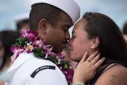 161223-N-KC128-0316 JOINT BASE PEARL HARBOR-HICKAM, Hawaii (December 23, 2016) A Sailor greets his loved one pierside at Joint Base Pearl Harbor-Hickam after the arrival of the Los Angeles-class attack submarine USS Buffalo (SSN 715) following the completion of her deployment to the Western Pacific Ocean. (U.S. Navy photo by Mass Communication Specialist 1st Class Daniel Hinton)