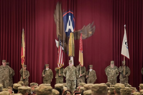 Soldiers of the 451st Sustainment Command (Expeditionary) prepare to case their color and guideon during their transfer of authority ceremony to the 316th ESC at Camp Arifjan, Kuwait, Dec. 23, 2016. (U.S. Army Photo by Staff Sgt. Dalton Smith)