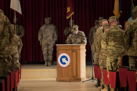 Lt. Col. David Langer, a chaplain with the 451st Sustainment Command (Expeditionary), reads the invocation before the 451st ESC and 316th ESC transfer of authority ceremony at Camp Arifjan, Kuwait, Dec. 23, 2016. (U.S. Army Photo by Staff Sgt. Dalton Smith)