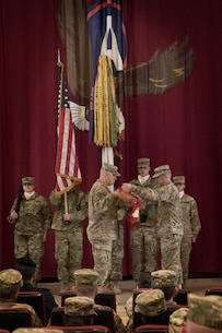 Brig. Gen. Bruce Hackett, the commanding general of the 451st Sustainment Command (Expeditionary), and Command Sgt. Maj. Dennis Thomas, the senior enlisted advisor of the 451st ESC, case their colors during the transfer of authority ceremony to the 316th ESC at Camp Arifjan, Kuwait, Dec. 23, 2016. (U.S. Army Photo by Staff Sgt. Dalton Smith)