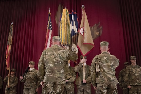 Brig. Gen. Robert Harter, the commanding general of the 316th Sustainment Command (Expeditionary), and Command Sgt. Maj. Johnny McPeek, the senior enlisted advisor of the 316th ESC, salute their recently uncased colors during their transfer of authority ceremony from the 451st ESC at Camp Arifjan, Kuwait, Dec. 23, 2016. (U.S. Army Photo by Staff Sgt. Dalton Smith)
