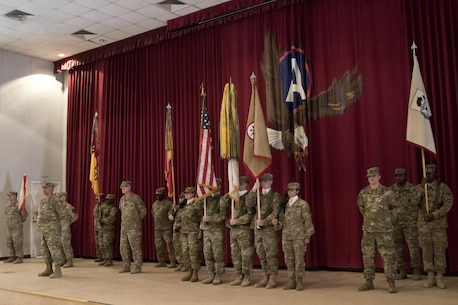 Col. Curtis Henry, chief of staff of the 316th Sustainment Command (Expeditionary), calls a color guard to parade rest during a transfer of authority transfer of authority ceremony at Camp Arifjan, Kuwait, Dec. 23, 2016. (U.S. Army Photo by Staff Sgt. Dalton Smith)