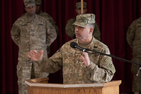 1st Sustainment Command (Theater) Commander Maj. Gen. Paul C. Hurley Jr., U.S. Army Central deputy commanding general, gives remarks during the 451st Sustainment Command (Expeditionary) and 316th ESC transfer of authority ceremony at Camp Arifjan, Kuwait, Dec. 23, 2016. (U.S. Army Photo by Staff Sgt. Dalton Smith)