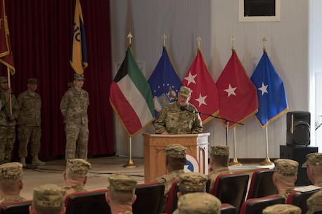 Brig. Gen. Robert Harter, the commanding general of the 316th Sustainment Command (Expeditionary), gives remarks during the 451st ESC and 316th ESC transfer of authority ceremony at Camp Arifjan, Kuwait, Dec. 23, 2016. (U.S. Army Photo by Staff Sgt. Dalton Smith)