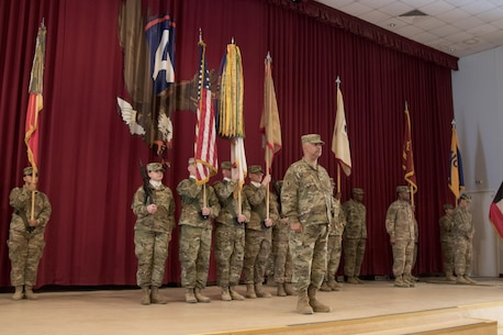 Col. Curtis Henry, the chief of staff of the 316th Sustainment Command (Expeditionary), calls a color guard to attention during a transfer of authority ceremony at Camp Arifjan, Kuwait, Dec. 23, 2016. (U.S. Army Photo by Staff Sgt. Dalton Smith)