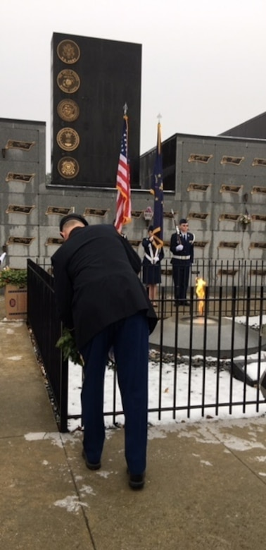 Army Reserve Staff Sgt. Bobby L. Scott, from the 310th Sustainment Command (Expeditionary), headquartered at Fort Benjamin Harrison, in Indianapolis, Ind., places a wreath in front of a grave stone at the Crown Hill National Cemetery in Indianapolis, Ind., Dec. 17, 2016. The Wreaths Across America ceremony is held annually on the second or third Saturday in December across the U.S. to honor the fallen.