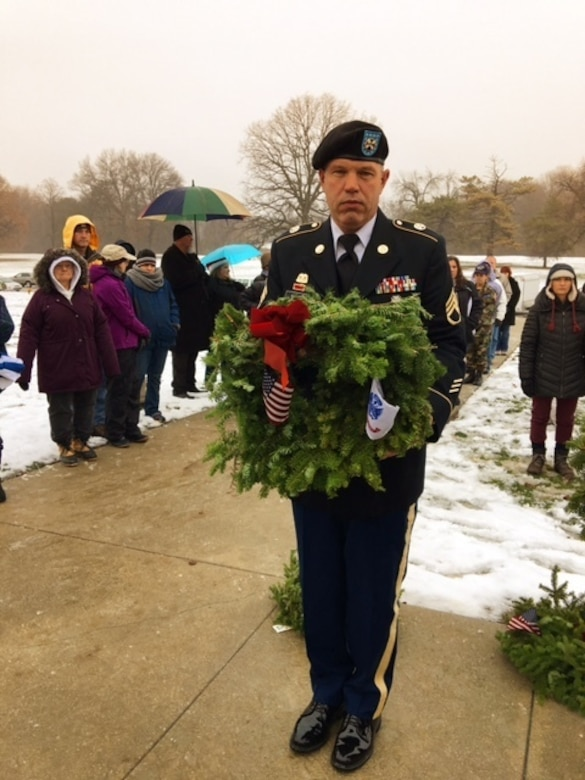 Army Reserve Staff Sgt. Bobby L. Scott, from the 310th Sustainment Command (Expeditionary), headquartered at Fort Benjamin Harrison, in Indianapolis, Ind., ready to place a wreath in front of a grave stone at the Crown Hill National Cemetery in Indianapolis, Ind., Dec. 17, 2016. The Wreaths Across America ceremony is held annually on the second or third Saturday in December across the U.S. to honor the fallen.