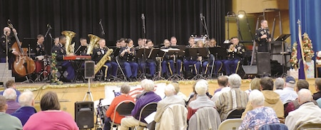 """Soldiers from the 1st Infantry Division Band perform at the Pearl Harbor Day concert Dec. 7 at the Peace Memorial Auditorium in Manhattan, Kansas. """"We love playing in this facility because of the history and how much it shows Fort Riley and the 1st Infantry Division is supported in the community,"""" said Spc. Lawrence Evans, senior producer for the band. """"We love playing here."""""""