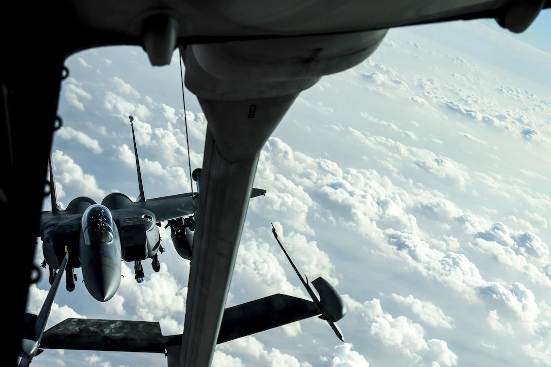An F-15E Strike Eagle prepares to receive fuel from a KC-10 Extender over Iraq.