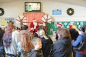 A crowd waits in line to meet Santa Claus Dec. 20, 2016, at Cedar Lane Elementary School in Olivehurst, California. Marysville Joint Unified School District's homeless students and their families attended Breakfast with Santa and received hot breakfast and gifts donated by the community. (U.S. Air Force photo by Senior Airman Tara R. Abrahams)