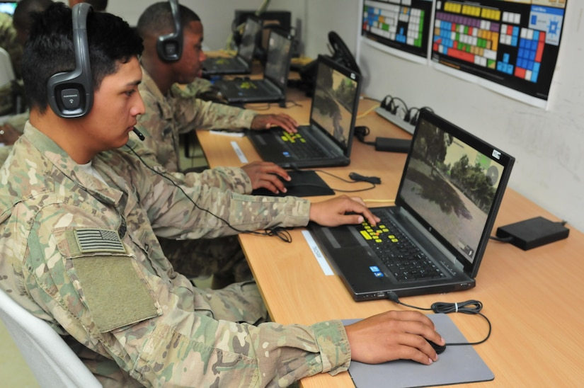 Pfc. Elyas Rosellini, an M1 armor crewman with the 1st Battalion, 67th Armored Regiment, moves his virtual avatar through a computer exercise during the second phase of squad overmatch training at Camp Buehring, Kuwait Dec. 14, 2016. The unique training opportunity incorporated a multi-platform teaching approach built on existing Army warrior skills training programs with detailed focus on improving situational awareness, psychological resilience, teamwork, tactical combat casualty care, and human performance enhancement. (U.S. Army photo by Sgt. Aaron Ellerman)