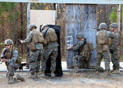 Marines place a detonation cord linear charge on a door for an urban assault breaching range during a deployment for training exercise at Fort Pickett, Va., Dec. 8, 2016. The purpose of the training was to prepare the Marines for real-world scenarios in assault breaching. The Marines are with Charlie Company, 2nd Combat Engineer Battalion. (U.S. Marine Corps photo by Sgt. Clemente C. Garcia)