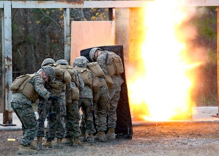 Marines take cover while setting off a detonation cord linear charge for an urban assault breaching range during a deployment for training exercise at Fort Pickett, Va., Dec. 8, 2016. The range was an opportunity for the Marines to practice the fundamentals of their job in an assault breaching. The Marines are with Charlie Company, 2nd Combat Engineer Battalion. (U.S. Marine Corps photo by Sgt. Clemente C. Garcia)