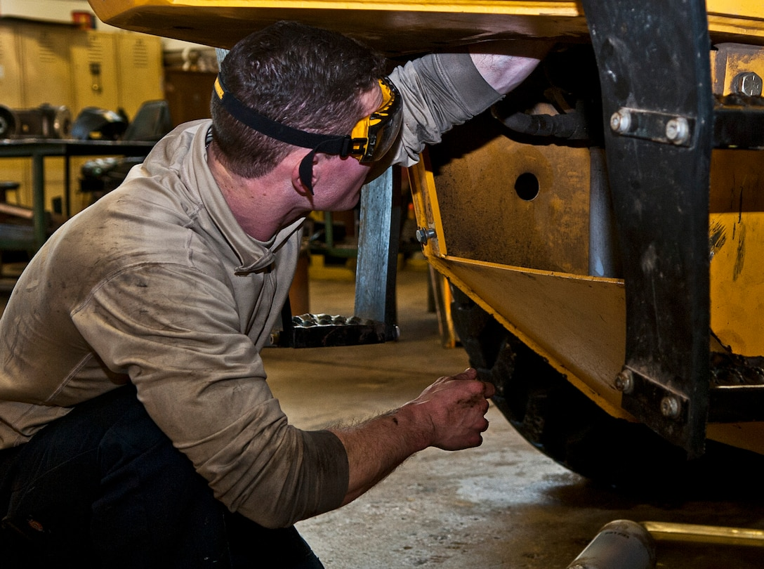 Airman 1st Class Brennan Walley, 5th Logistics Readiness Squadron vehicle maintenance technician, tightens a bolt on a grader vehicle at Minot Air Force Base, N.D., Dec. 14, 2016. The 5th LRS special purpose maintainers are trained to perform inspections, repairs and rebuild vehicle components and assemblies. (U.S. Air Force photo/Airman 1st Class Jonathan McElderry)