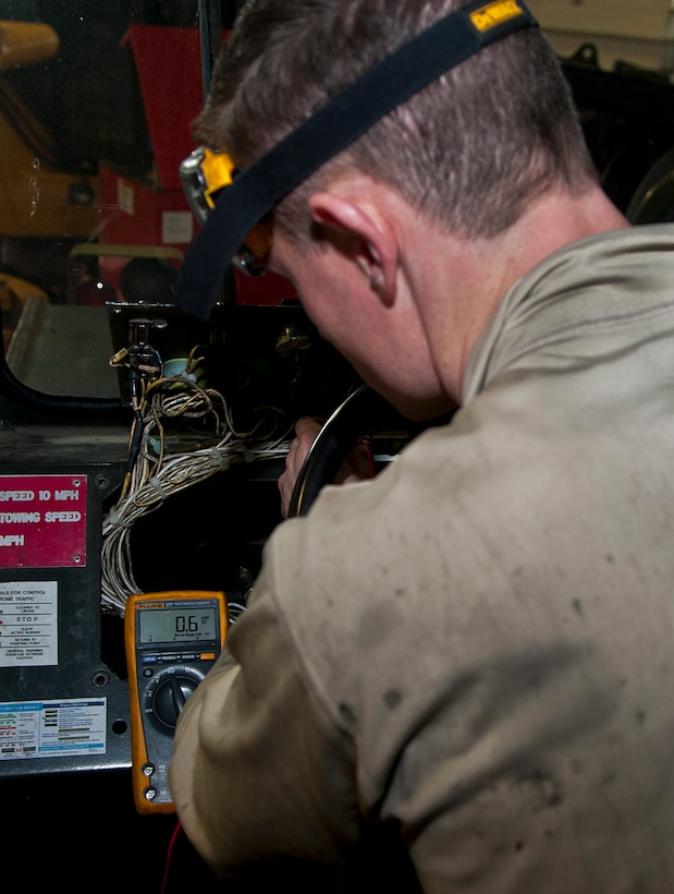 Airman 1st Class Brennan Walley, 5th Logistics Readiness Squadron vehicle maintenance technician, tests an electrical circuit at Minot Air Force Base, N.D., Dec. 14, 2016. Airmen in the 5th LRS special purpose shop are responsible for servicing all Minot AFB vehicles to ensure base operations continue running smoothly. (U.S. Air Force photo/Airman 1st Class Jonathan McElderry)