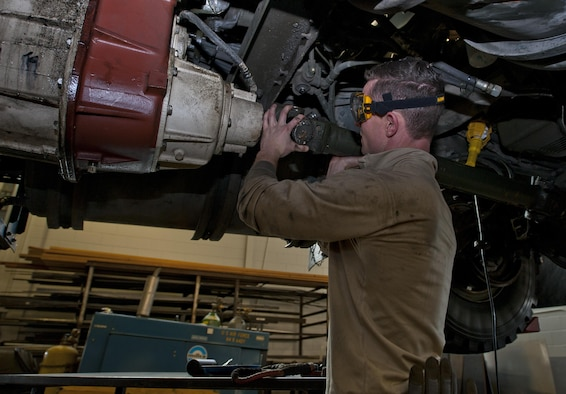 Airman 1st Class Brennan Walley, 5th Logistics Readiness Squadron vehicle maintenance technician, installs a drive shaft on a snow blower at Minot Air Force Base, N.D., Dec. 14, 2016. Airmen in the 5th LRS special purpose shop perform maintenance on various types of equipment, from gasoline and diesel engines, to hydraulic and air systems. (U.S. Air Force photo/Airman 1st Class Jonathan McElderry)