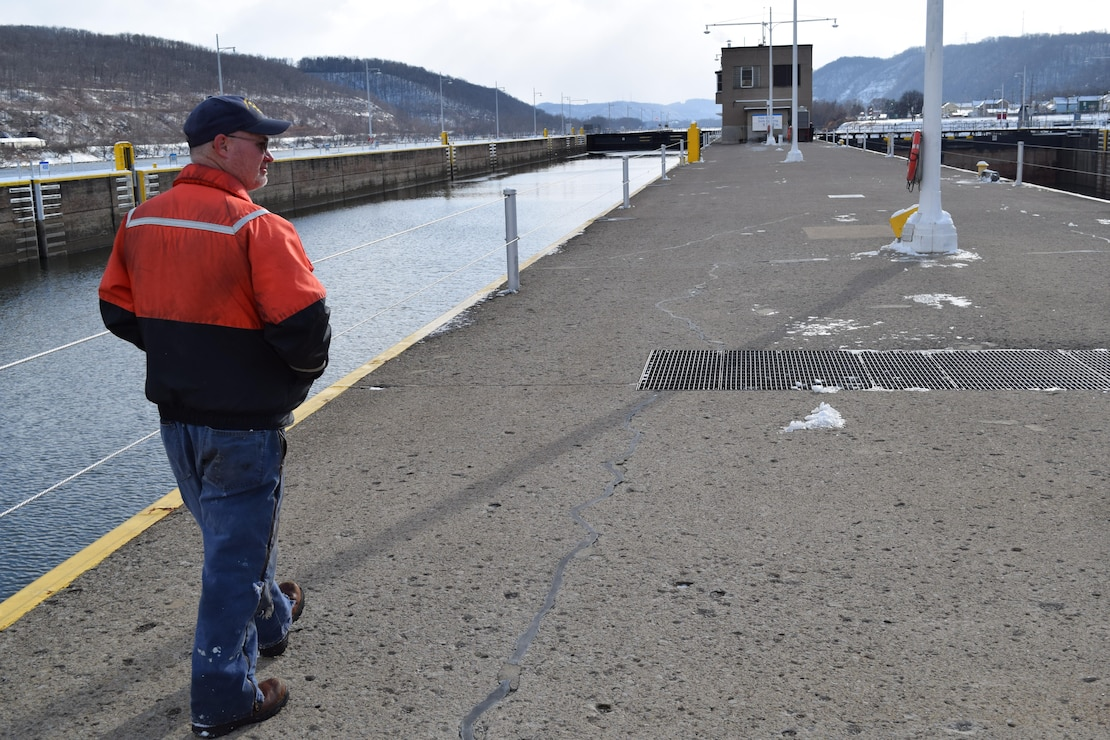 Lockmaster Willie Maynard at New Cumberland Locks and Dam walks along the middle wall toward the downstream end of the facility where crews are working to fix a hydraulic failure that closed the upper Ohio River to commercial traffic.
