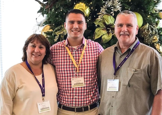 Staff Sgt. Dale N. Ransom (center) and parents Donna and Dale attend a Yellow Ribbon Program event in Orlando, Florida on December 17, 2016. The Air Force Reserve Yellow Ribbon Program is designed to assist reservists and National Guard members in maintaining resiliency as they transition between their military and civilian roles before, during and after deployment. (U.S. Air Force photo by Capt. Brian Haun)